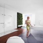 Hansa má místo běžné sprchové vaničky na podlahu z oblázků. Příjemná masáž pro chodidla. Koncept Signatur.