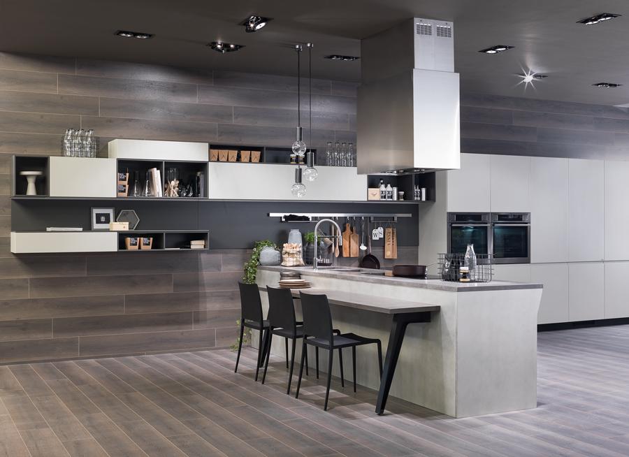 Zvolíte-li pracovní desku z keramiky, můžete stejný materiál použít i na podlahu nebo mezi skříňky.