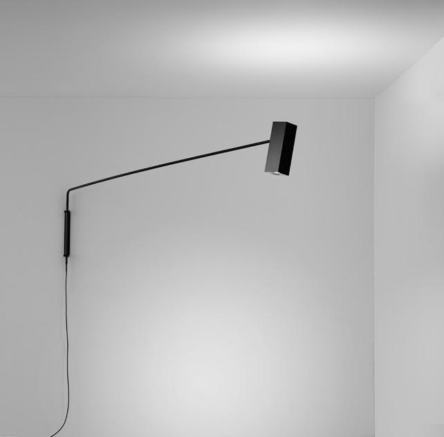 Stůl můžete osvětli také pomocí nástěnné lampy s výsuvným ramenem. Svítidlo Dejavu, Modo Luce